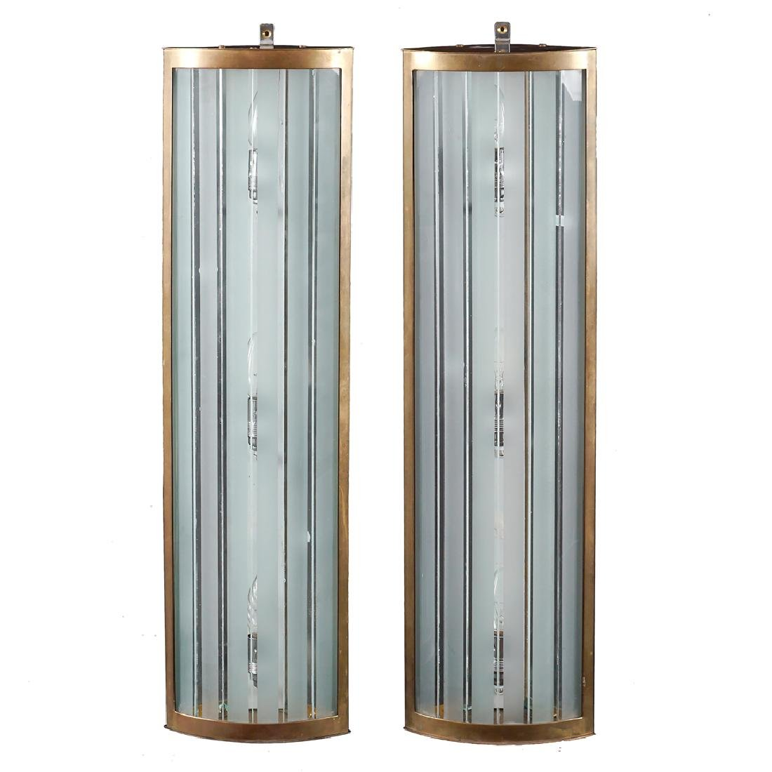 A pair of Art Decò shaped appliques 20th century