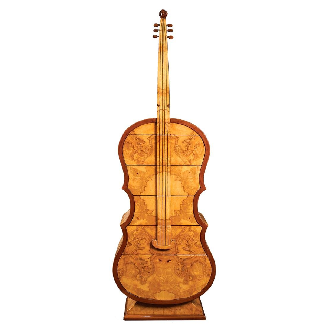A cello shaped dresser 20th century 155x50x34 cm.