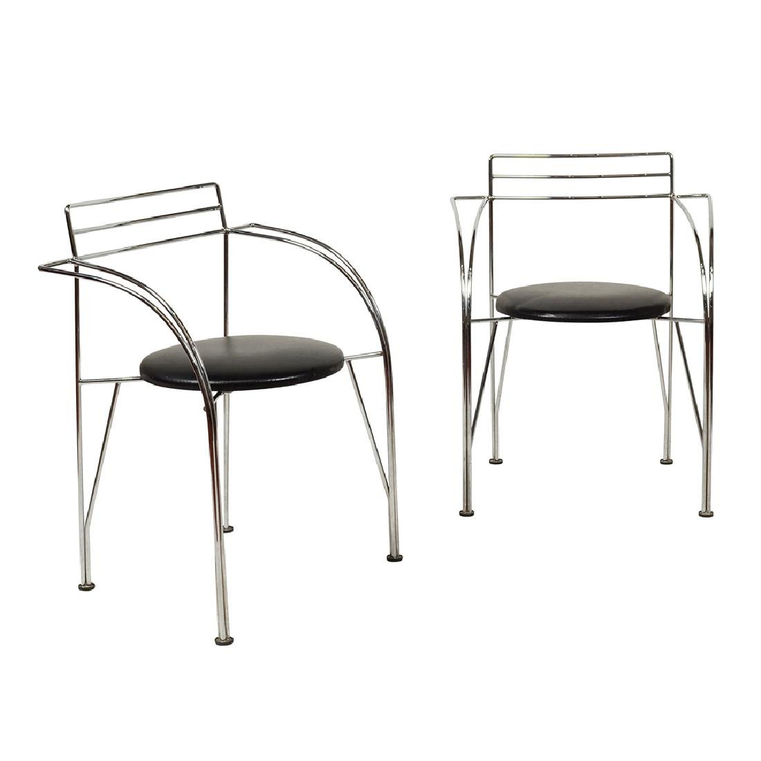 Pair of chairs with armrests France 20th century