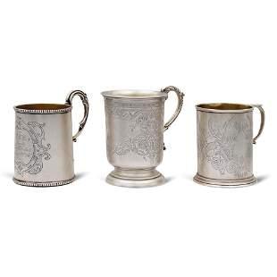 Three silver and vermeil mugs England 19th century