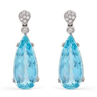 18kt white gold earrings with two pendant aquamarines