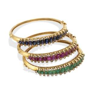 Three 18kt yellow gold, rubies, sapphires and emerald