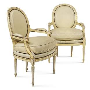 """A pair of armchairs in lacquered wood """"Louis XVI"""""""