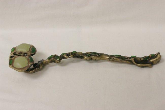 "Chinese bronze ruyi with Peking glass inset, 10.7""L"