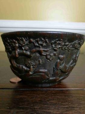 A heavy Chinese wood bowl with figure story carving