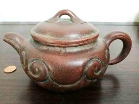 A Chinese Ruyi style handmade yixing teapot with