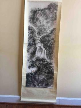 A Chinese scroll painting of mountain and waterfall
