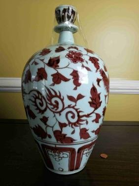 A Chinese Iron red painted long vase