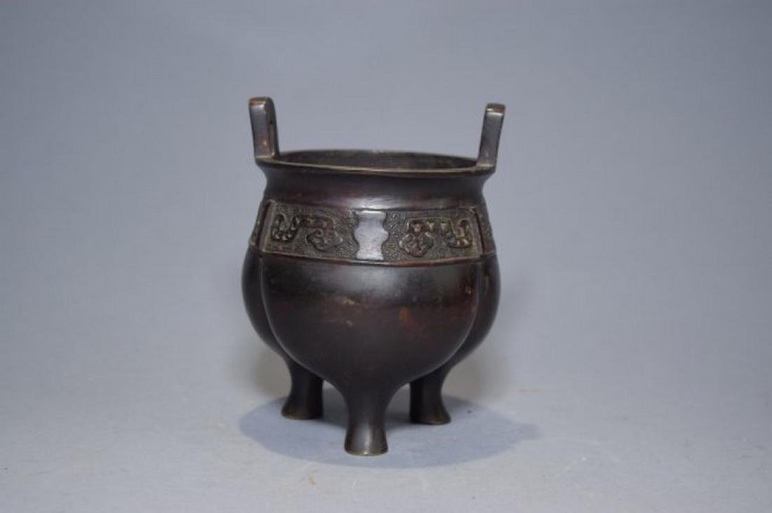 19th C. Chinese bronze three-footed censer. Age wear.