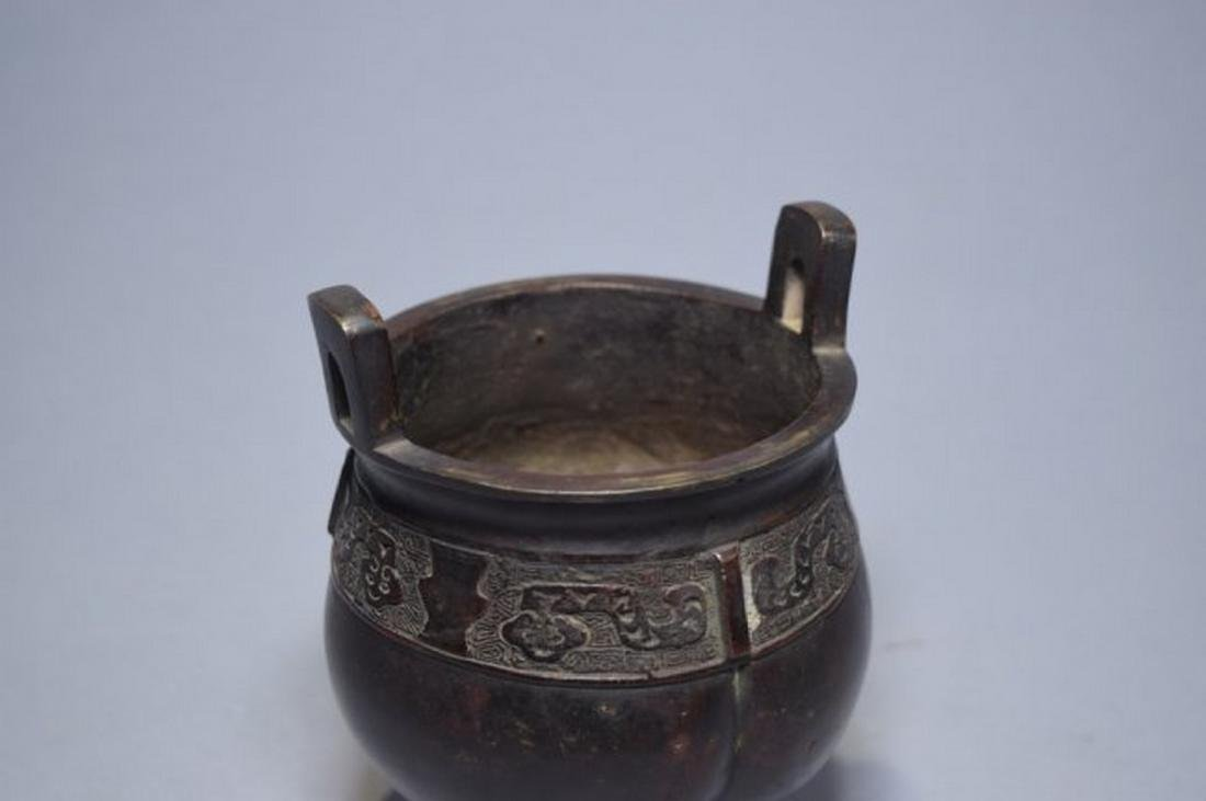19th C. Chinese bronze three-footed censer. Age wear. - 2