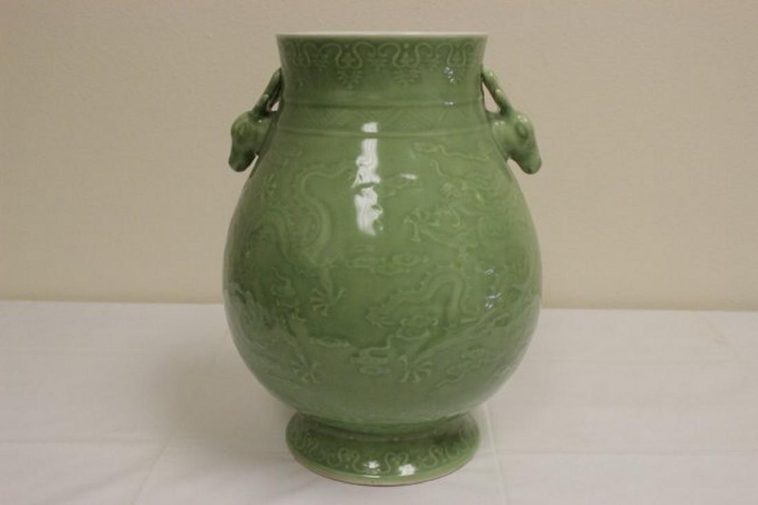 Chinese celadon jar with deer motif handles
