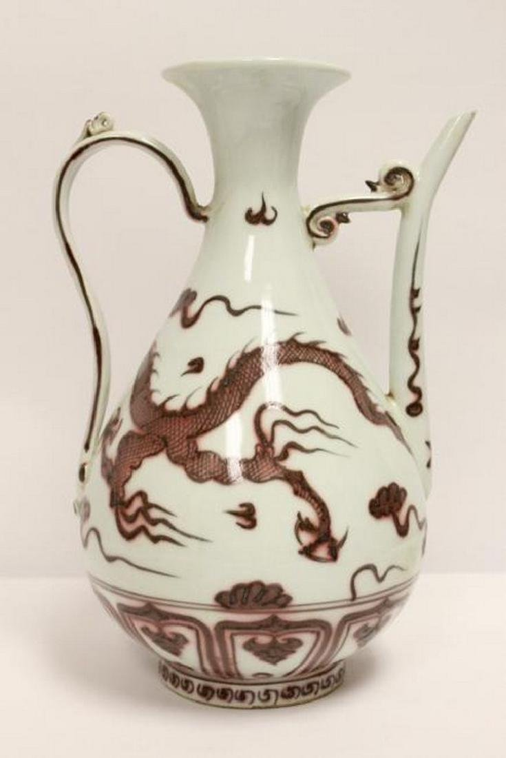 A Chinese red and white porcelain wine server