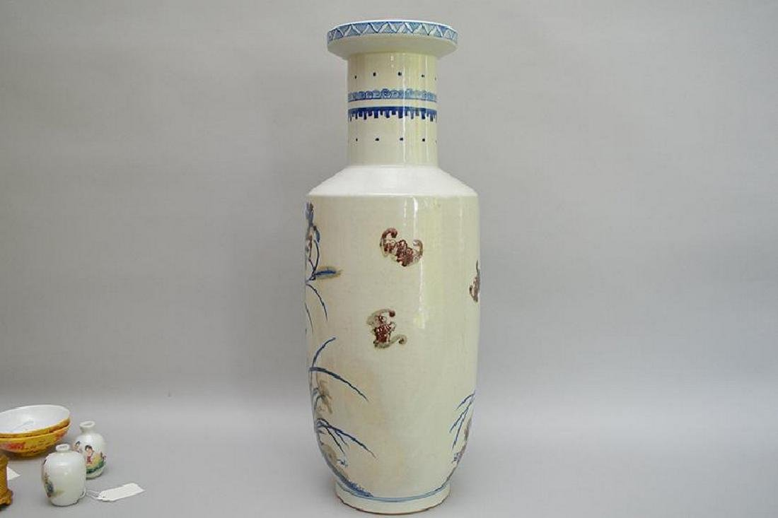 Chinese Porcelain Vase with blue & purple flowers on a