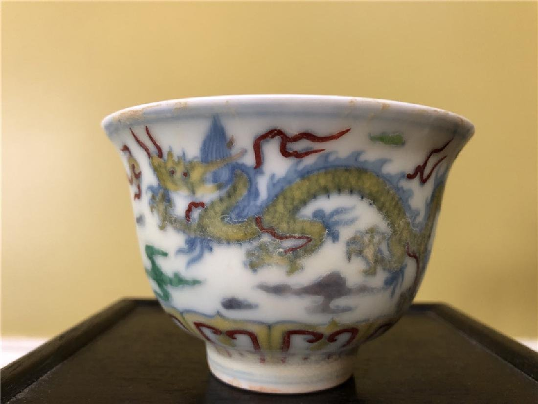 A Chinese Ming Dynasty porcelain cup with dragon