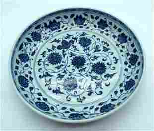 A large Chinese blue and white porcelain dish decorated
