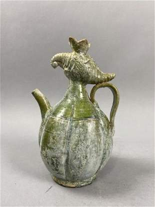 Green glazed wind head pot of Han Dynasty or later