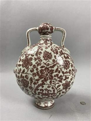 Ming Dynasty style red vase with ear and flower pattern