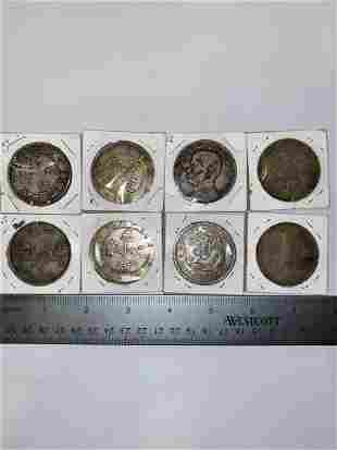 Set of eight Chinese republic silver coins, dragon