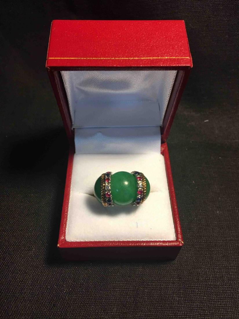 A goleden ring with jade and gem
