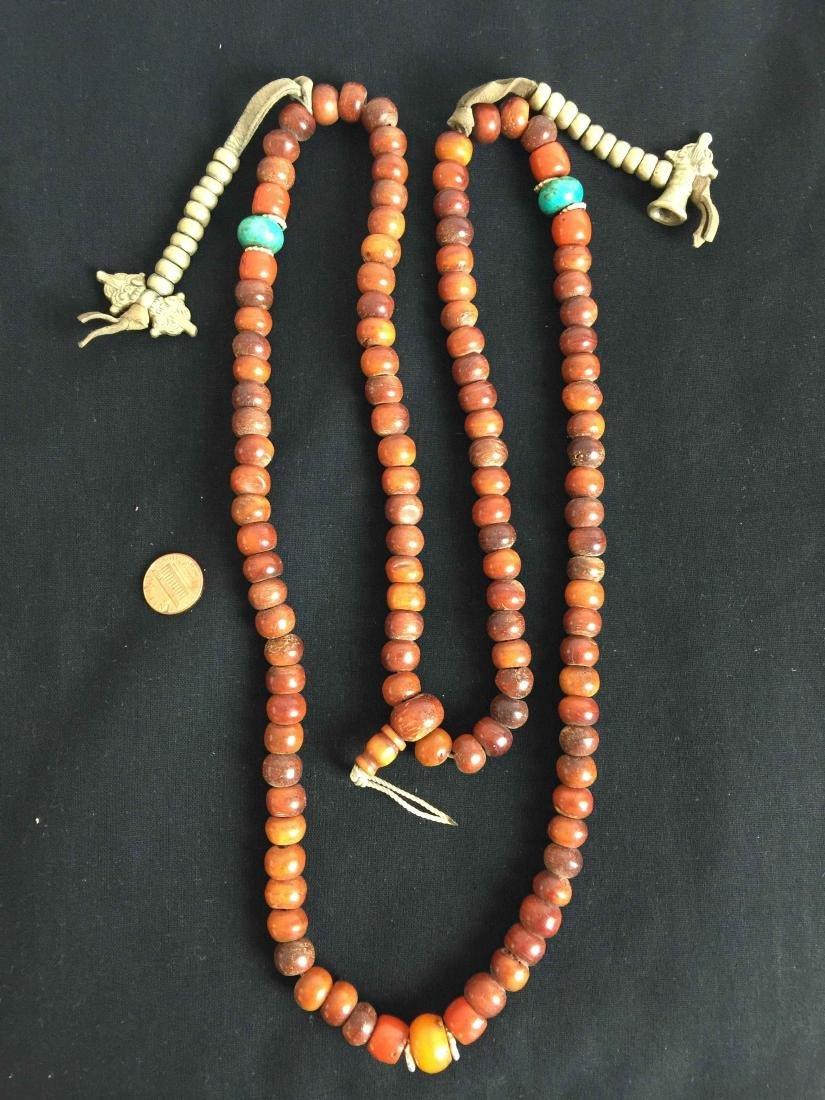 coral buddha beads