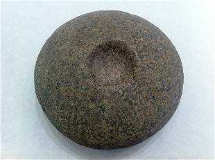 A large American Indian discoidal of speckled granite