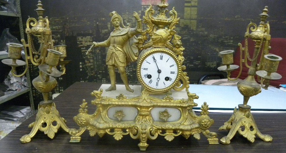 ANTIQUE BRONZE GILDED FRENCH CLOCK WITH CANDELABRA PAIR