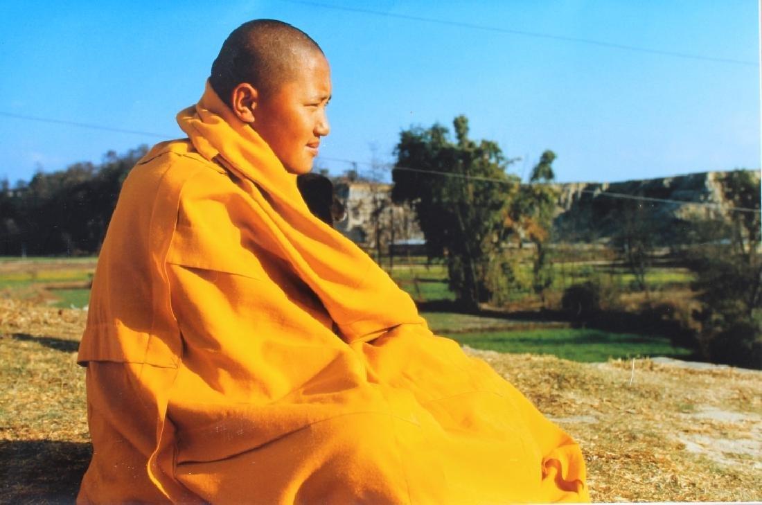 4 large color photographs of Buddist Monks