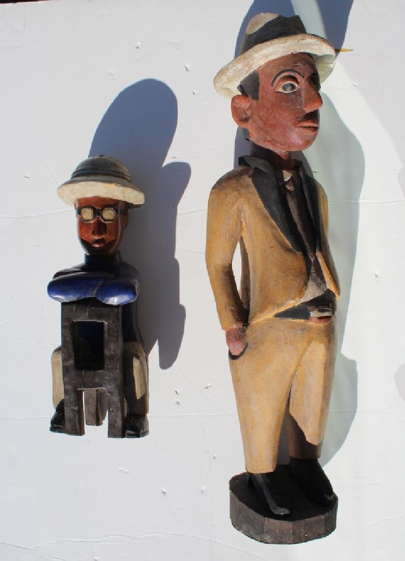 Pair of African made wood dolls