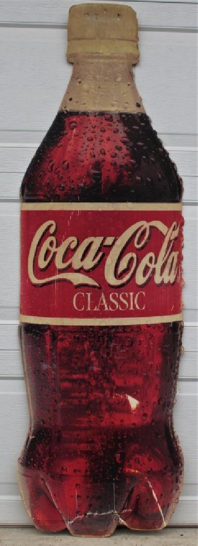 Coca Cola bottle shape sign