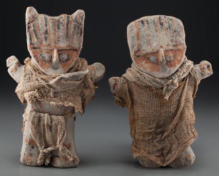 A Pair of Chancay Polychrome Ceramic Dolls
