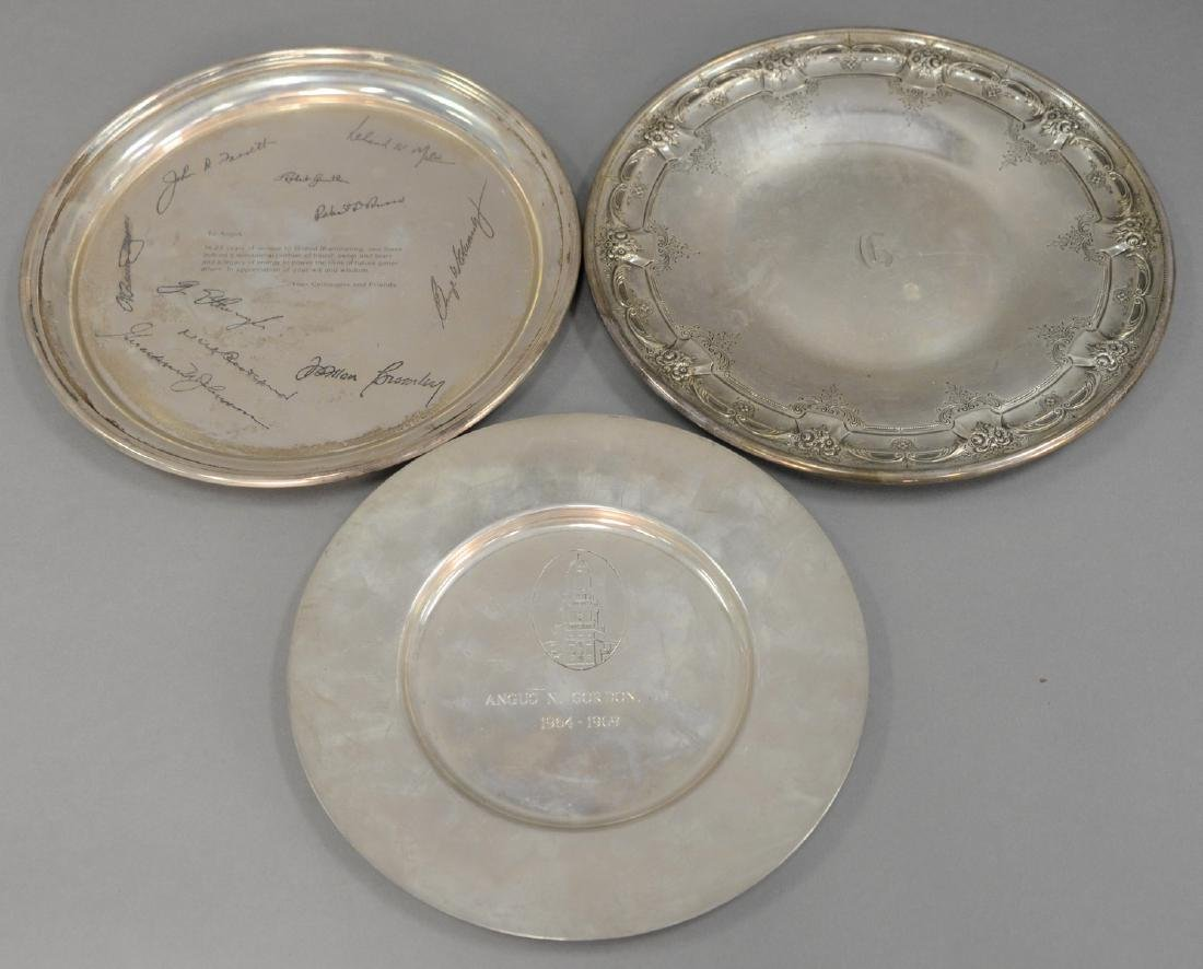 Three sterling silver plates. 9-10 1/2 in., 30.6 t oz.