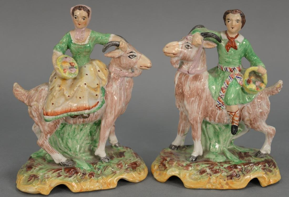 Pair of Staffordshire figures of boy and girl on goats.