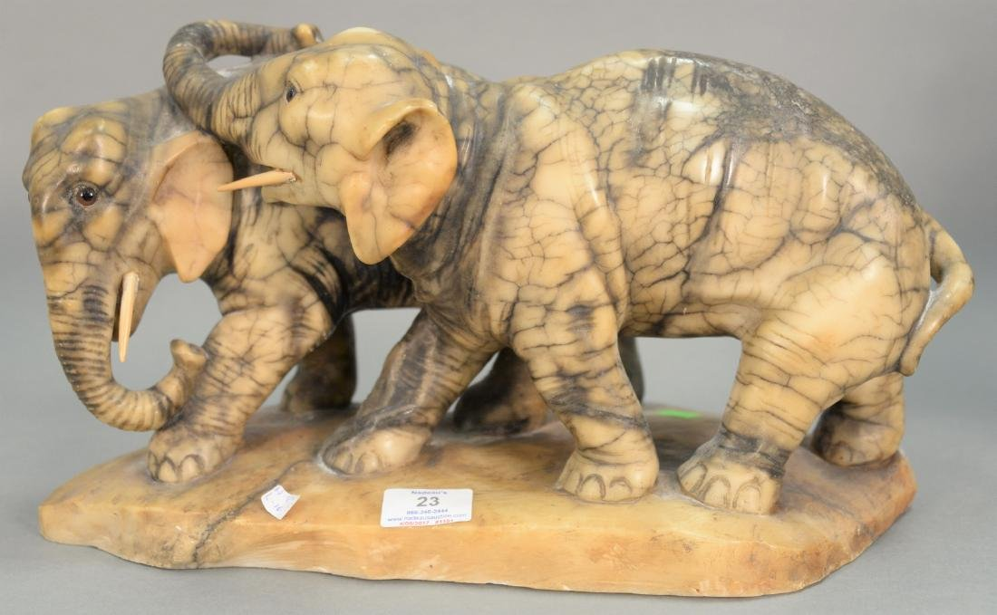 Marble sculpture of two elephants with glass eyes,