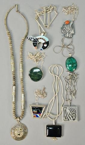 Eight necklaces, all with pendants, six with stones.