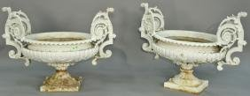 Pair of Victorian iron urns, each with large scroll