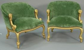 Pair of custom upholstered club chairs with gilt rope