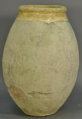 Large pottery vase with remnants of yellow glazing. ht.