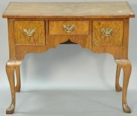 Burl mahogany veneered dressing table. ht. 28in., wd.