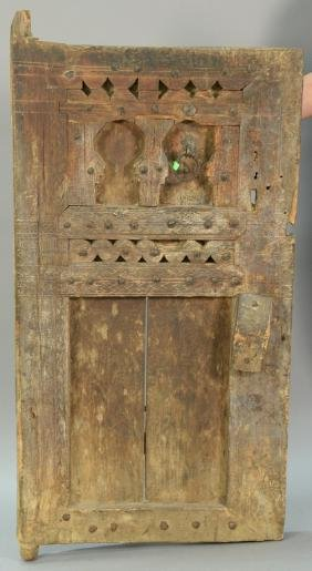 Primitive carved door and large steel head nail