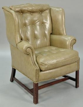 Leather upholstered wing chair on Chippendale style