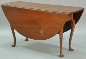 Queen Anne cherry table with oval drop leaves set on