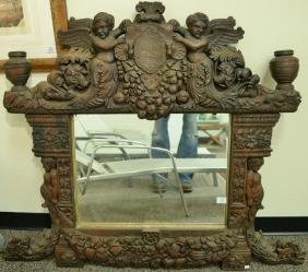 Large figural Italian classical style oak mirror having
