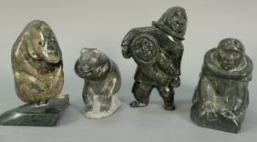 Four Inuit Eskimo carvings including Bear, Woman