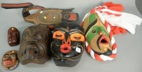 Six Eskimo Inuit carved figures and masks including