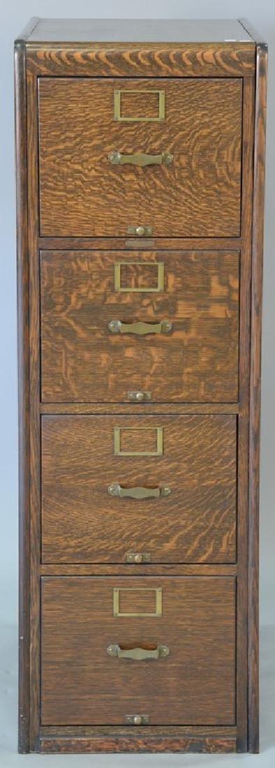 Remington Rand oak four drawer file cabinet. ht. 52in.,
