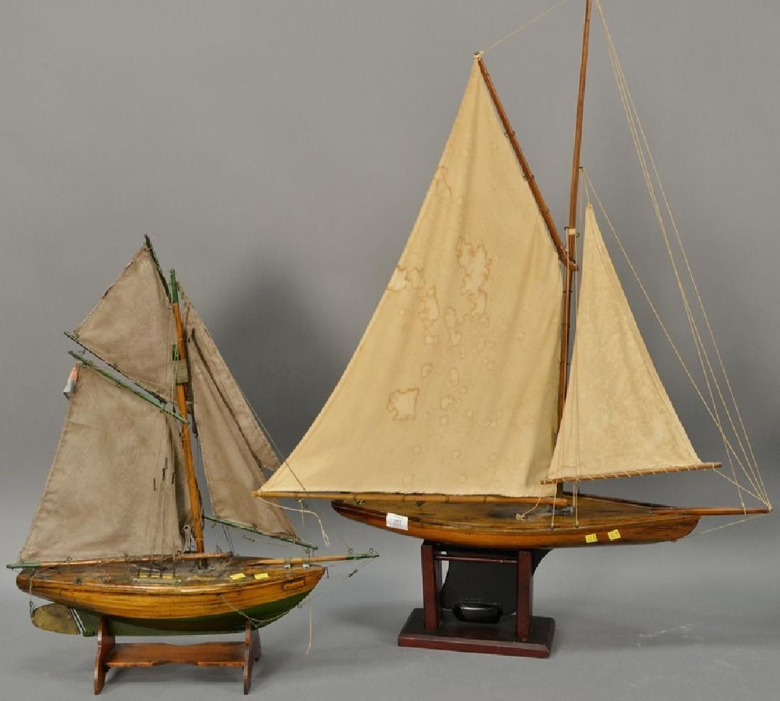 Two vintage wood pond boats. lg. 23in. & 28in.