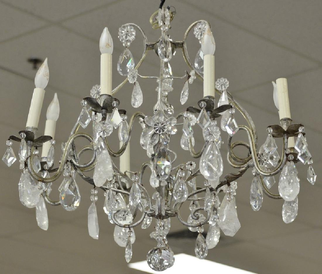 Eight light chandelier having rock crystal and crystal