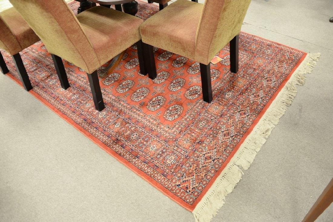 """Karastan Oriental Bokhara style carpet. 5'9"""" x 9'2"""""""