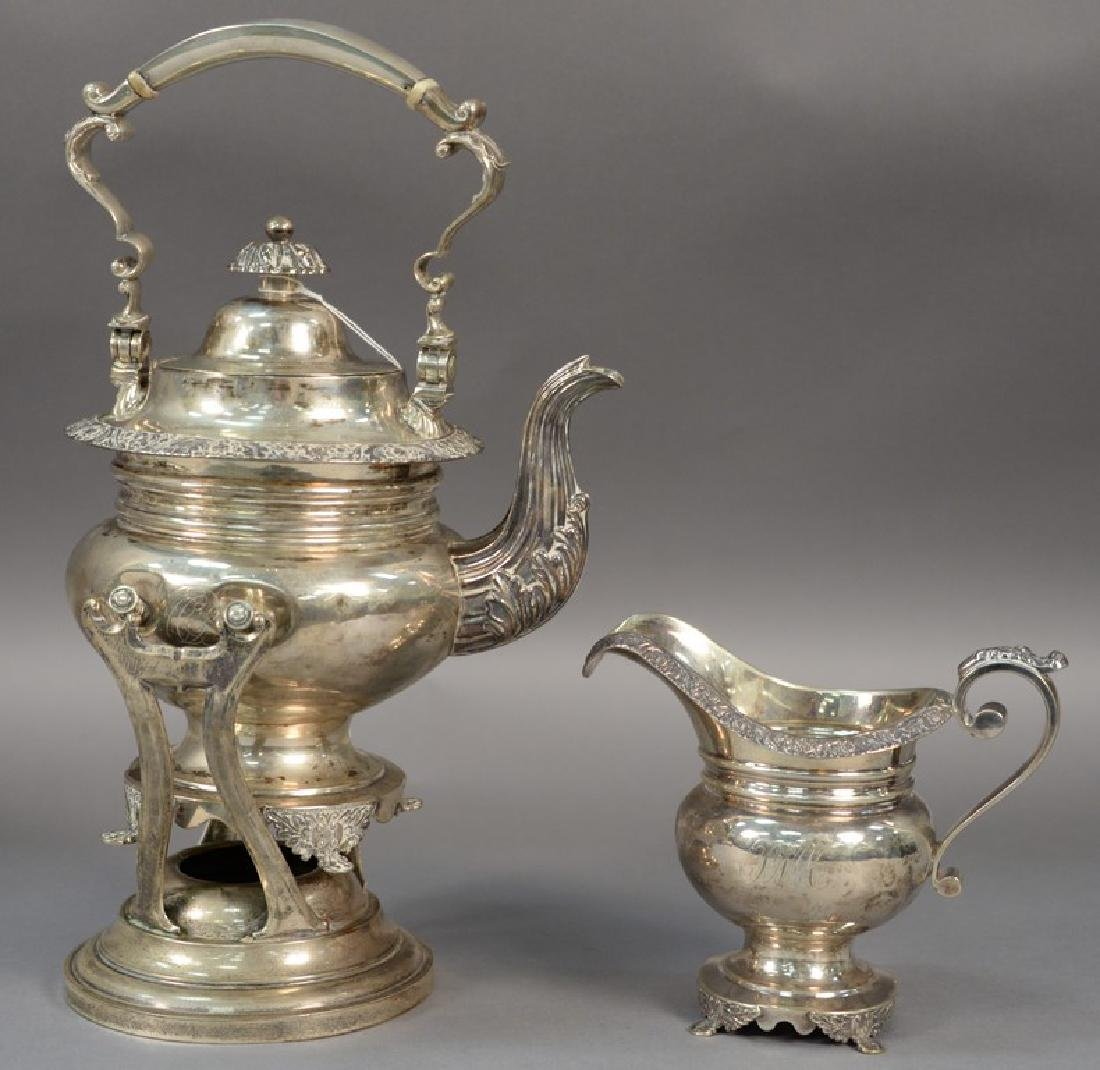 Two piece silver set including a hot water pot on stand