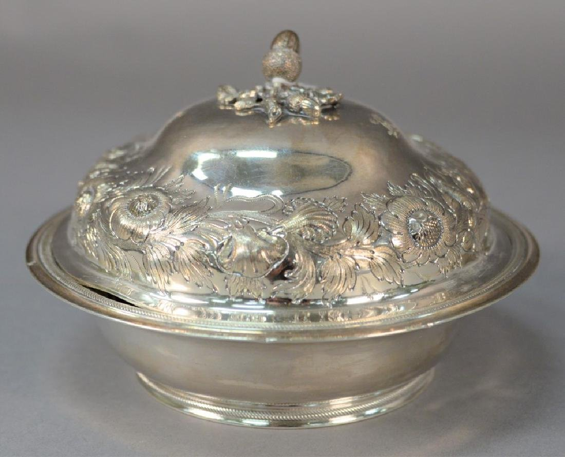 Silver butter dish with repousse cover and acorn top